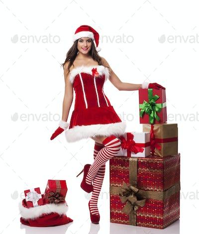Sexy santa woman with christmas presents