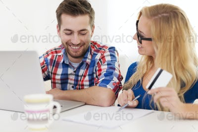 Couple paying bills by credit card