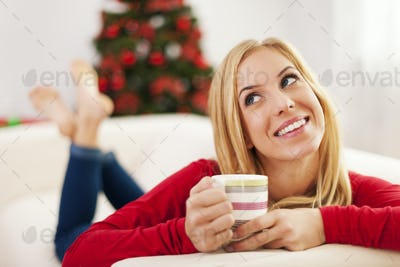 Beautiful woman dreaming about christmas presents