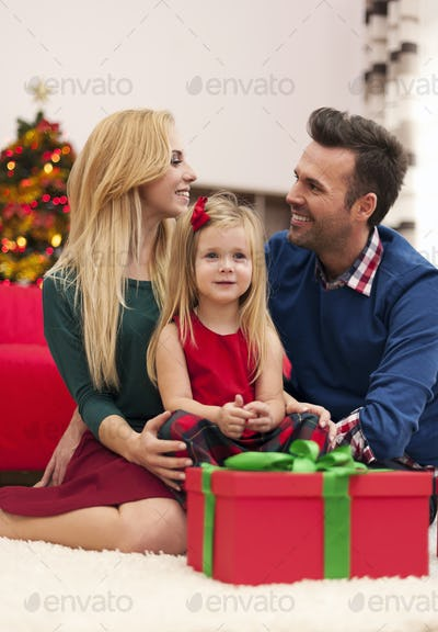 Young marriage with their daughter spending christmas together