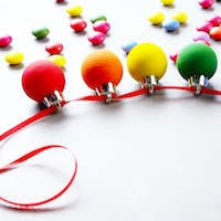 Hand made painted Christmas decoration balls in colors of rainbo