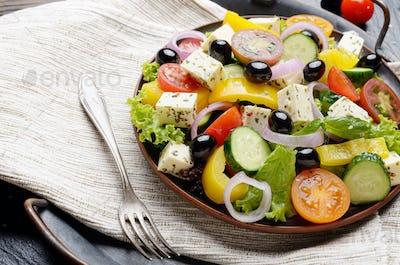 Mediterranean diet dish greek salad on vintage metal tray closeu
