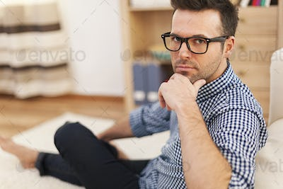 Portrait of serious man in domestic room
