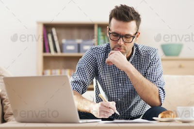 Portrait of focus man working at home