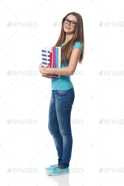 Portrait of smiling and beautiful female student