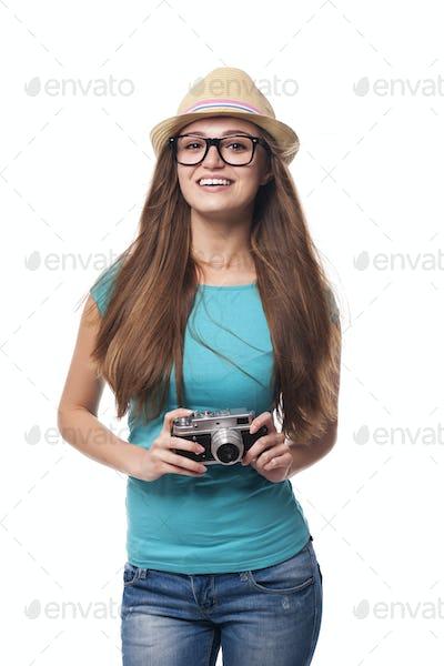 Summer girl with retro camera