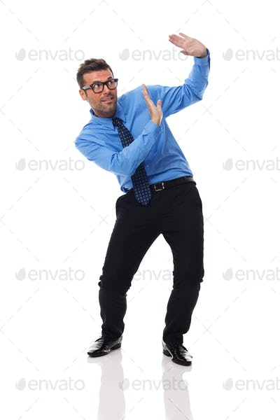 Scared businessman benting under the weight of something