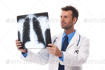 Male doctor examining x-ray image