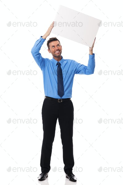 Smiling businessman holding blank placard