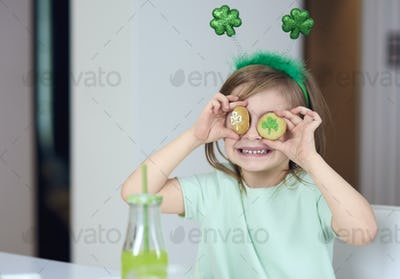 Cheerful girl with cookie having a fun