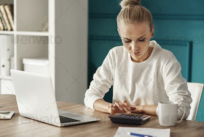 Serious woman planning her budget