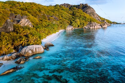 Golden hour at Anse Source D Argent exotic beach at Seychelles. Aerial drone photo from above
