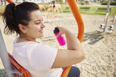 Young, happy woman exercising outdoors