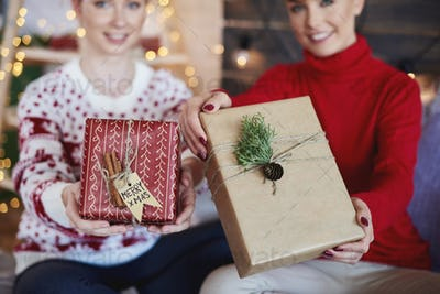 Woman's hands giving christmas presents