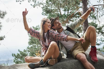 Couple making a selfie during hiking trip