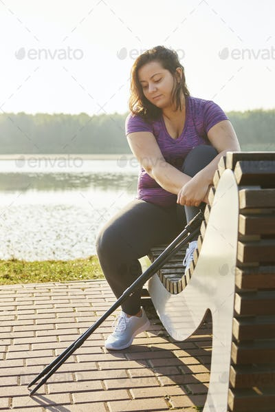 Woman with hiking poles taking a short break