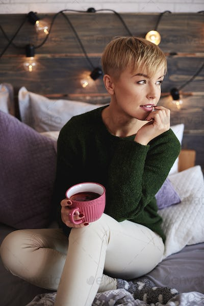 Young woman drinking tea in winter day
