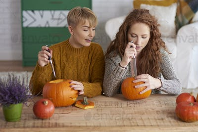 Girls making decorations for Halloween