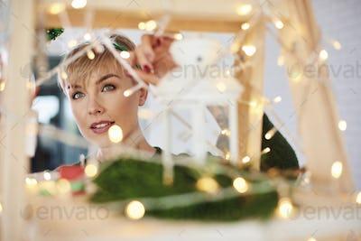 Woman's face among christmas lights
