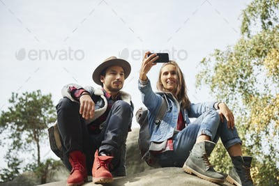 Happy couple making a selfie during hiking trip