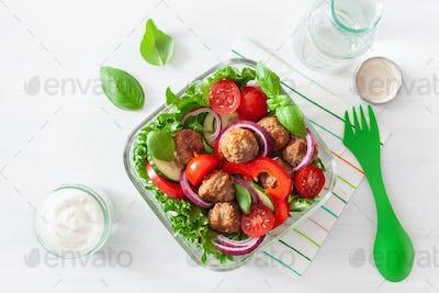 keto paleo lunch box with meatballs, lettuce, tomato, cucumber,