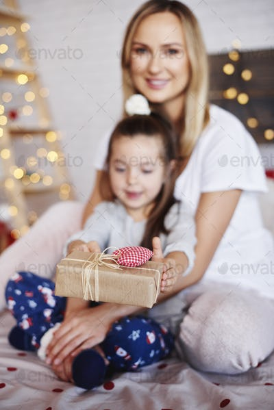 Child's hands giving the christmas presents