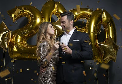 Loving couple making a toast to New Year