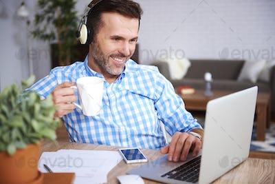 Multi tasking man working at home office