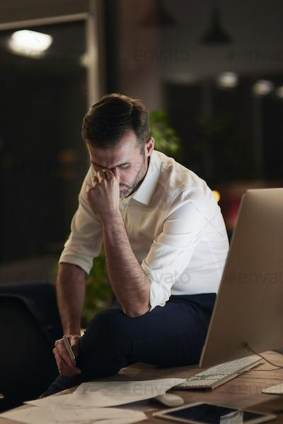 Tired businessman suffering from headache