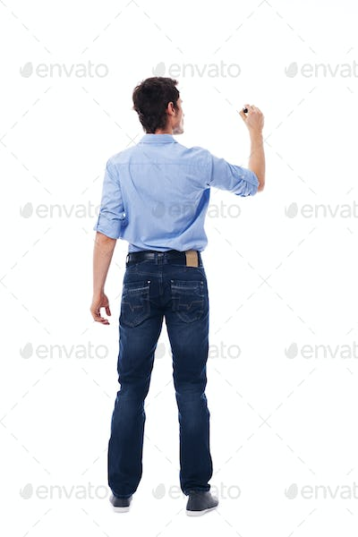 Adult male writing on the blank white wall