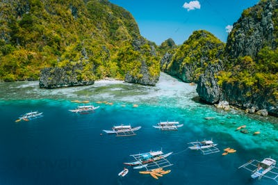 Aerial view of tourist boats in front of big Lagoon at Miniloc Island, El Nido, Palawan, Philippines