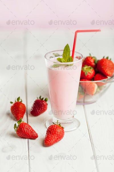 Strawberry milk shake in pastel colored