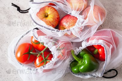 apples tomatoes bell peppers vegetables in reusable mesh nylon b