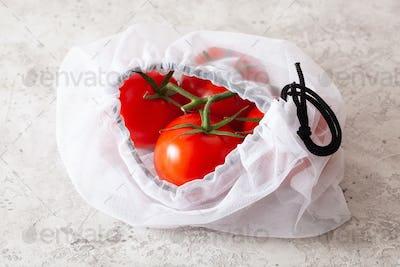 tomatoes in reusable mesh nylon bag, plastic free zero waste con