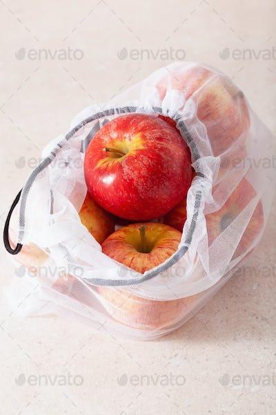 apples in reusable mesh nylon bag, plastic free zero waste conce