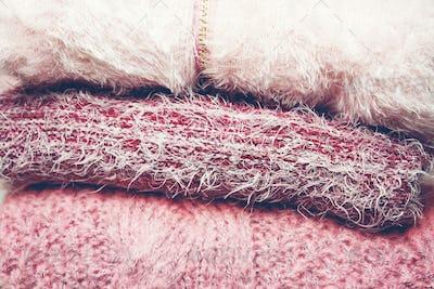 Beautiful woolen sweaters in pink tones