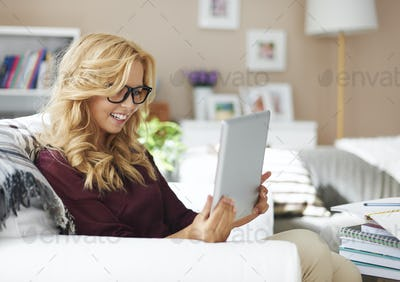 Blonde young girl with digital tablet at home