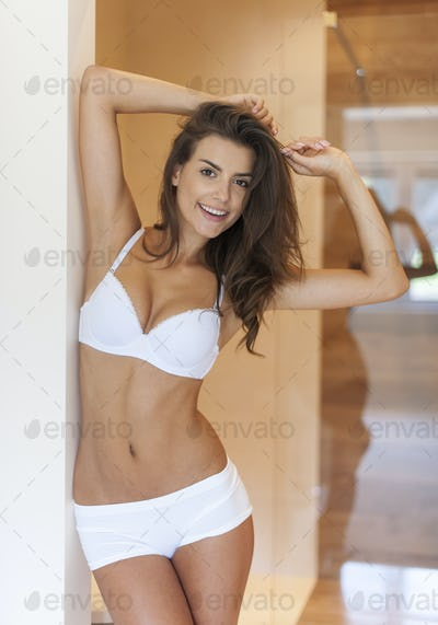 Beautiful smiling woman posing in underwear