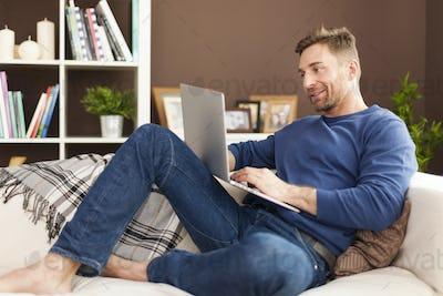Man enjoying the modern technology at home