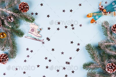 Christmas frame-postcard from decorative Christmas toys, fir, cones, balls, golden stars, sledge
