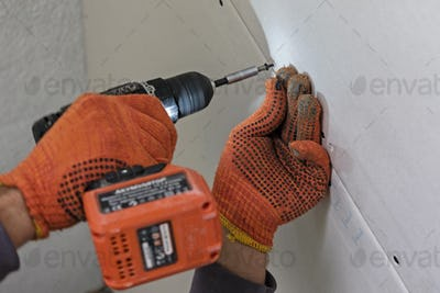 Fastening drywall process in close-up