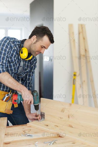 Carpenter creating new furniture