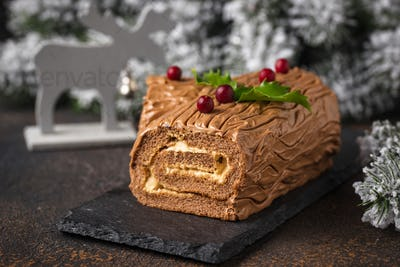 Christmas yule log cake. Traditional chocolate dessert