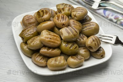 Dish with grilled green olives
