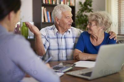 Senior couple making a financial deal