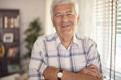 Portrait of vital old man in the living room