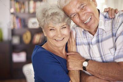Portrait of happy senior couple in arms