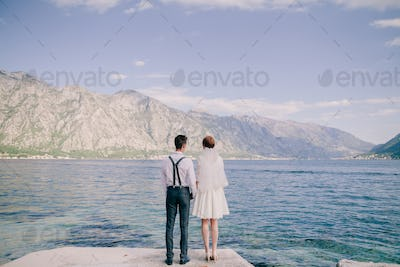 honeymoon wedding couple travel sea side back view