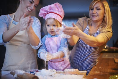 Play with flour during baking cake