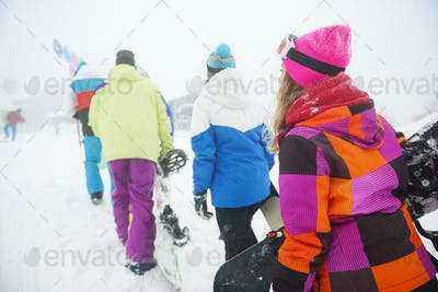 Climbing on the top of mountain in the winter